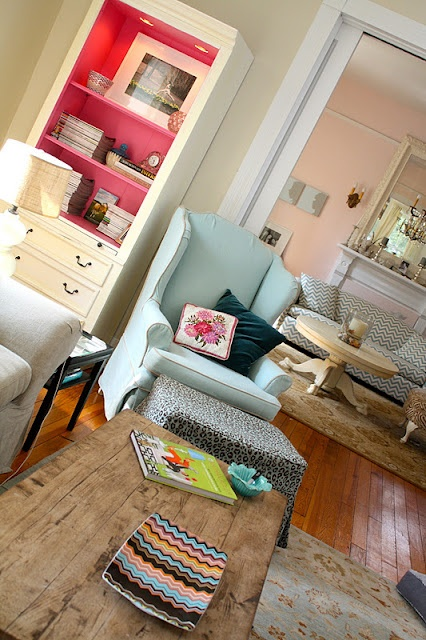 Aqua chair, coffee table, ottoman, the floors, the hutch, the couch in the background and that other table...love, love, love!
