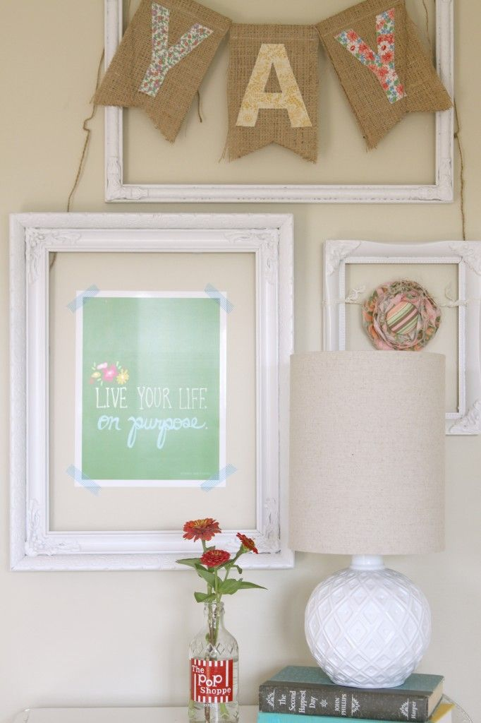Stick art to the walls with washi tape and hang an open frame around it. (with 3M Command picture strips)