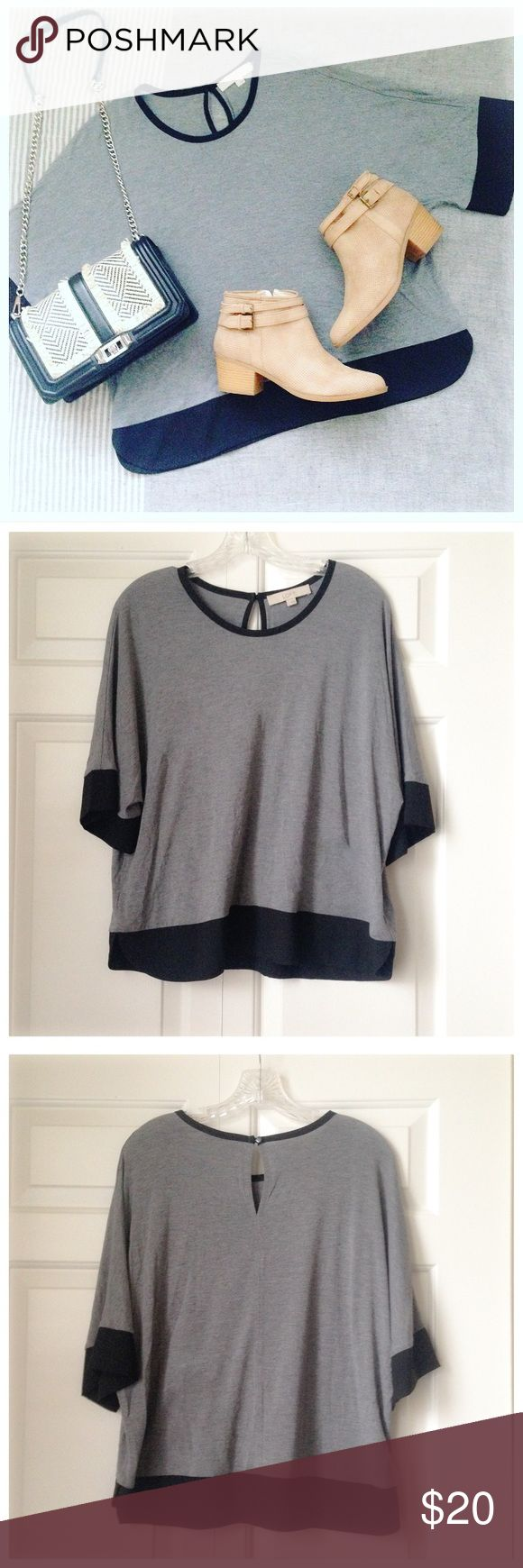 NWOT LOFT Grey and Black Batwing Top This NWOT grey and black batwing style top from Ann Taylor LOFT is simply chic! Such a fantastic wardrobe basic! With 3/4 sleeves, and an adorable keyhole feature on the back, this top is a must have for any fashionista. Just throw on with jeans and your favorite booties, and you're looking effortlessly stylish! ✨THIS ITEM IS NWOT NEVER WORN IN PERFECT CONDITION. ALL PURCHASES COME WITH LOVELY BONUS GIFTS✨ LOFT Tops Tees - Short Sleeve