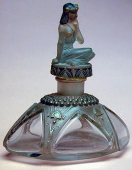 Dubarry Blue Lagoon   Designed by Julien Viard, circa 1919, bottle by Depinoix  The stopper in the shape of a seated Egyptian woman.