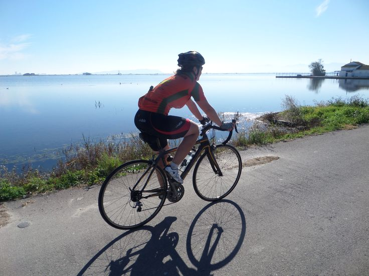 Cycling between the rice fields of Albufera. http://www.cyclefiesta.com/cycling-holidays/valencia.htm