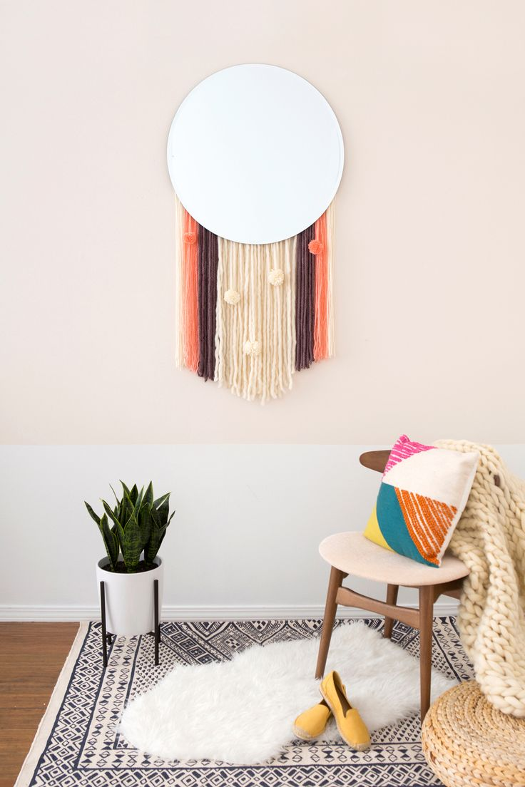 Boho Lovers, This DIY Statement Wall Hanging Mirror Is for You via Brit + Co
