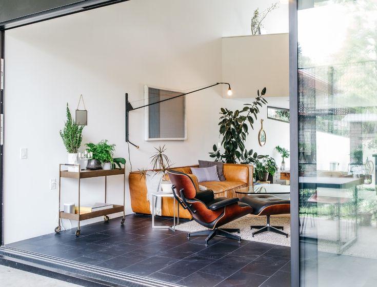 Noguchi coffee table mi-century design living room Eames lounge chair