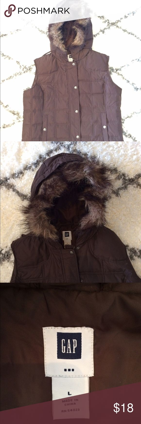 Gap fashion vest Brown vest from Gap with removable faux fur along the hood. Great item for the layered look!  Excellent condition! GAP Jackets & Coats Vests