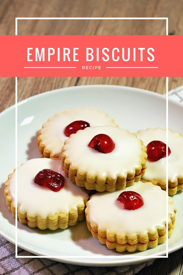 Empire Biscuits, also known as Iced Biscuits and German Biscuits, are lovely little biscuits, sandwiched together with jam and topped with a generous layer of icing and a cherry, or jelly sweetie on top.