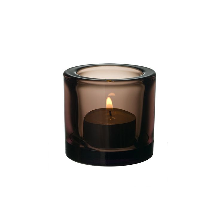 Give any room an ambient glow with this Kivi votive from Iittala. Made from wonderfully thick coloured glass, this votive enriches the flame's glow and multiplies it. With a wide range of colours to