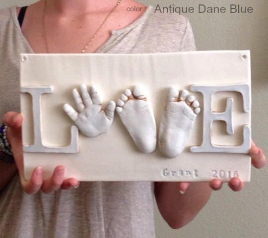 A personal favorite from my Etsy shop https://www.etsy.com/listing/532449742/infant-keepsake-art-hand-print-love