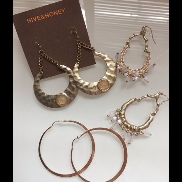 Three pairs of large hoops Three pairs costume jewelry large hoop earrings. One is Hive & Honey brand. Never worn. One pair is new with tags none have been worn. Jewelry Earrings