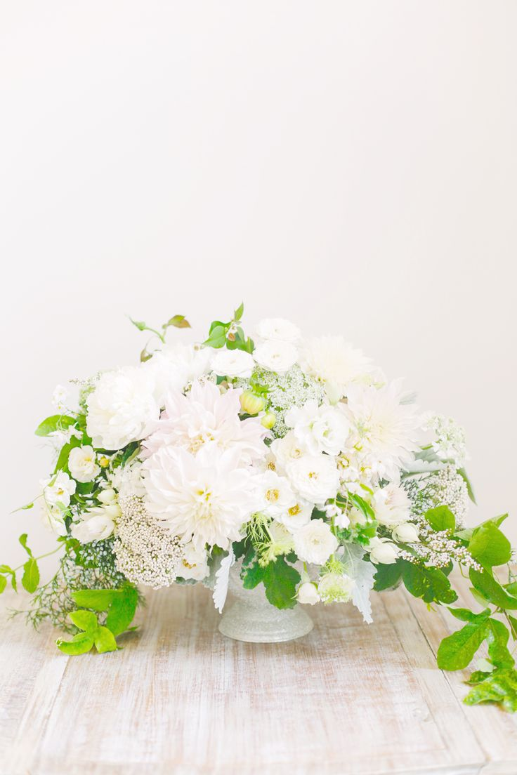 Lush white and green floral centerpiece. #wedding #flowers