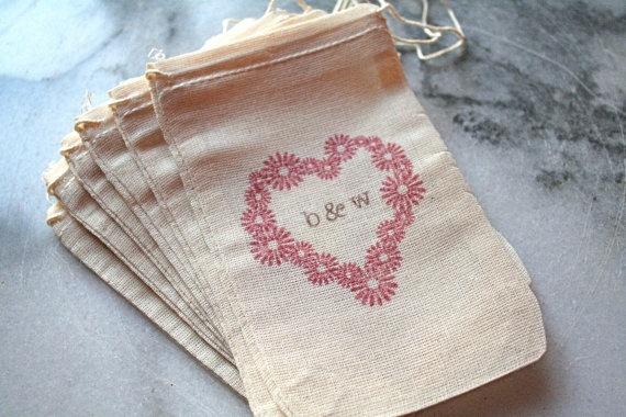 Wedding favor bags monogrammed.    http://www.nashvillewraps.com/organza-bags/cotton-drawstring-bags/c-039164.html