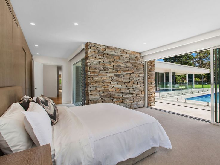 Eco Outdoor Baw Baw dry stone walling used as internal and external feature wall. Zias | Serenity Interior and Landscape Design | Eco Outdoor | livelifeoutdoors | Baw Baw dry stone walling | Outdoor design | Natural stone walling | Garden design | Outdoor paving | Outdoor design inspiration | Outdoor style | Outdoor ideas | Paving ideas | Contemporary garden design | Contemporary architecture | Stone walling ideas | Outdoor tiles | Stone tiles | Feature wall ideas | Luxury homes