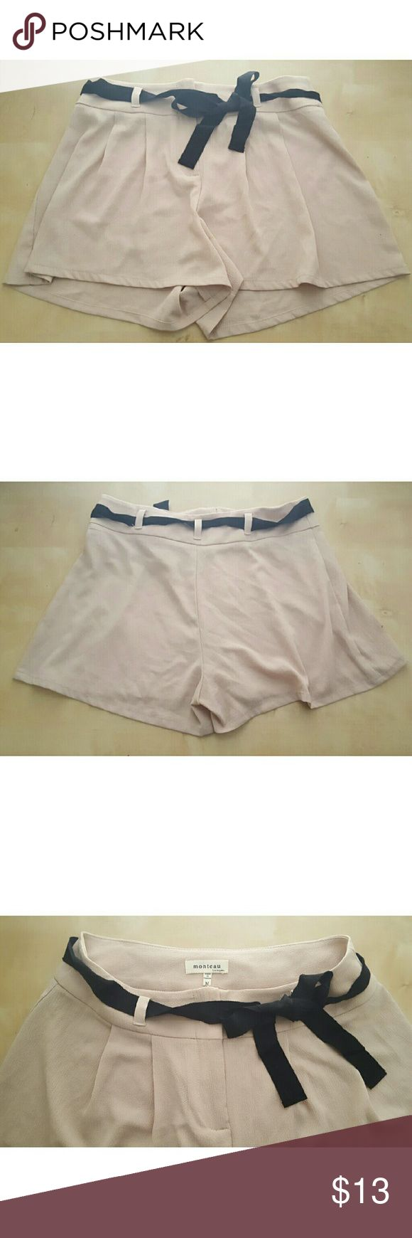 High-Waisted Beige Shorts with Belt These light and loose beige shorts are the perfect neutral base for any outfit. They are high-waisted and feature a black 1inch thick belt. Zipper in front. Lightly worn, Great condition! 95% Polyester and 5% Spandex Monteau Shorts