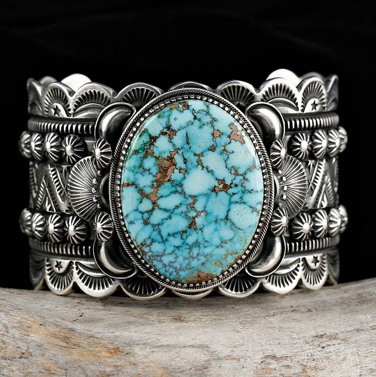 Cuff   Delbert Gordon (Navajo).  Sterling silver with Birdseye Turquoise Mountain Turquoise.