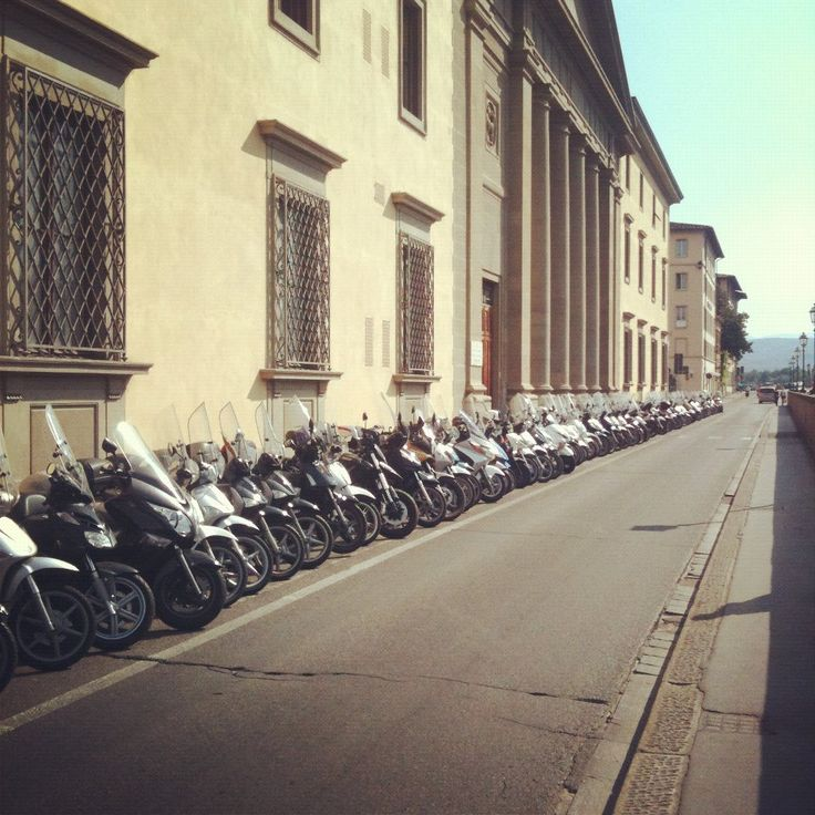 Way to keep moving. Row of scooters in Florence, Italy #Italy #scooters #travel #fromAtoB