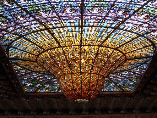 Detail of the one-ton inverted stained glass bell in the center of the ceiling ~  Palau de la Musica Catalana (Palace of Catalan Music), Barcelona -- built 1905-1908; designed by architect Lluís Domènech i Montaner [3rd of four pins]