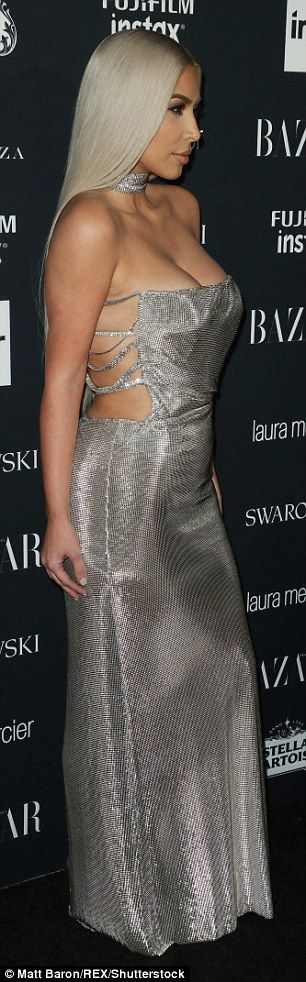 Sultry: After the awards ceremony, the 36-year-old changed into a low-cut silver Versace dress for the Harper's Bazaar Celebration of Icons By Carine Roitfeld event