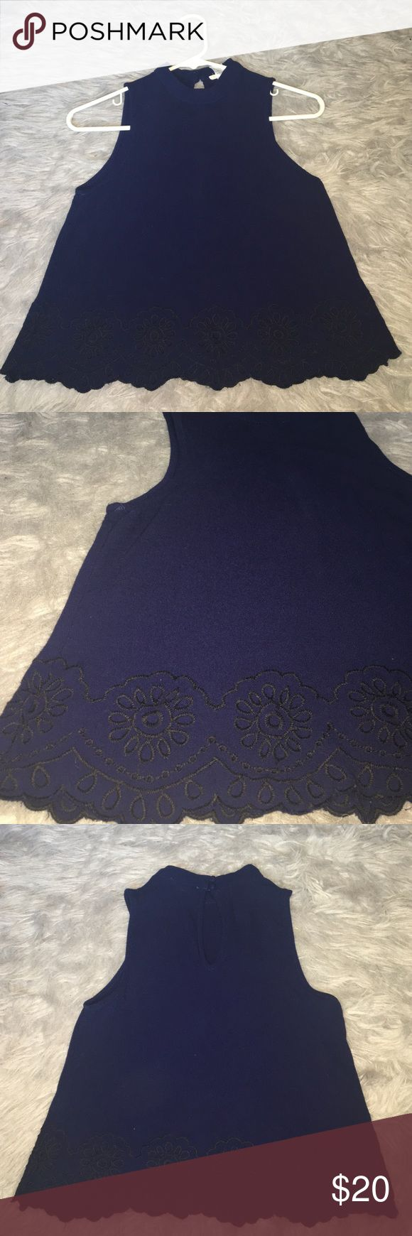 Navy blue crop top Beautiful navy blue cropped blouse with threaded flower embellishments. The neckline has additional vintage inspired button clasps. inTu Tops Crop Tops