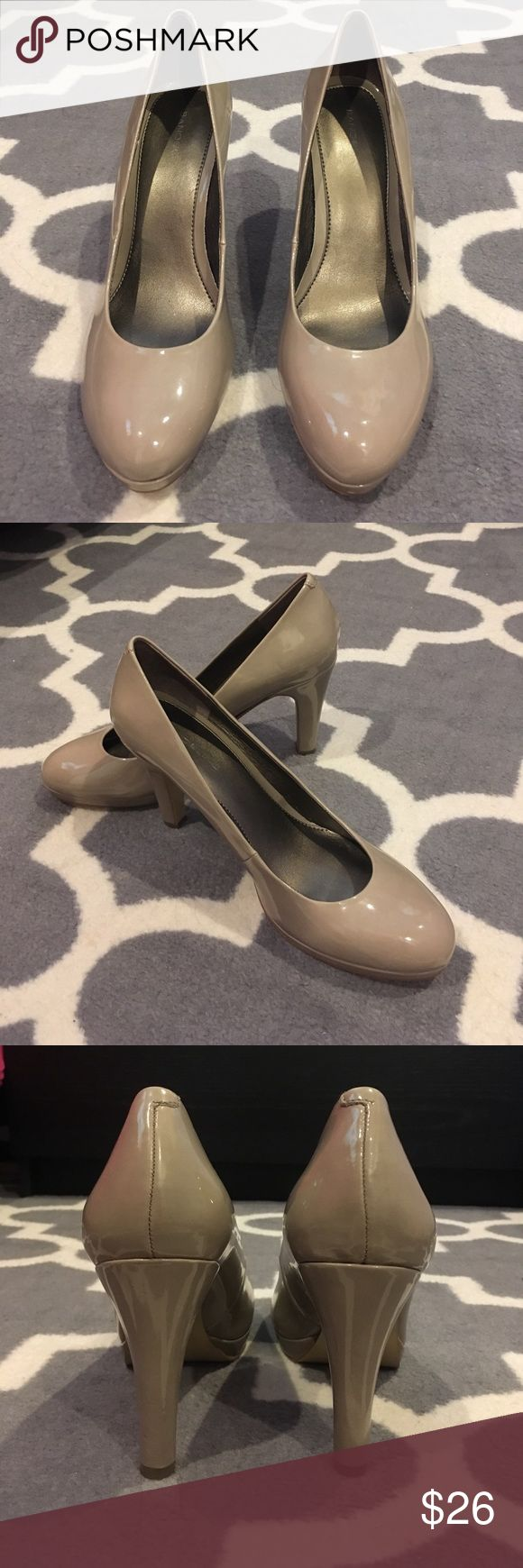 Beige Pumps Beige pumps with a glossy finish. Silver metallic inner lining. Approx. 3 inch heel. Size 9. From DSW. Bandolino Shoes Heels