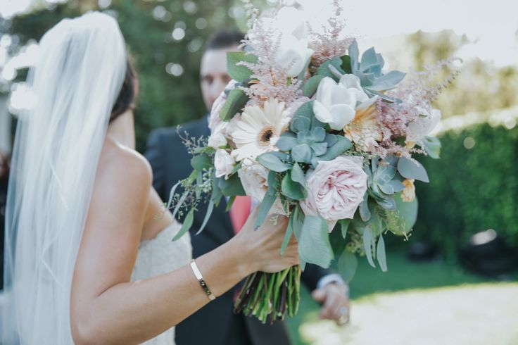 Brides Bouquet. Gerbera Daises, Blush Roses, Succulents, and Seeded Eucalyptus. Jenny Smith & Co.