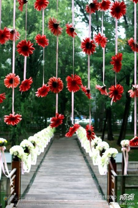 wedding decor - a simple idea but what a difference it will make in the photos! White daisies instead of red.
