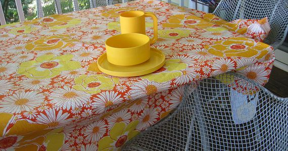 Vintage Daisy Oval Vinyl Flannel Backed Tablecloth.  Great 60s daisy motif in yellow, orange and reds. Fabric: Vinyl with white flannel backing  Size: Oval 84 inches x 60 inches  Condition: Very good condition with pristine whites. There is one small scuff might come out with soft scrub (see photo)?  Questions? Please ask. Thanks for looking.  (Note: Sale is for one tablecloth, not accessories.)
