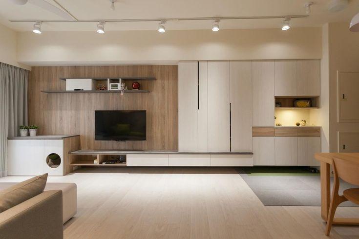 光是不同色系板材的跳色處理,展現電視牆面和諧的構圖比例,加上活潑線條與局部燈光畫龍點睛,專屬的設計品味不言而喻。