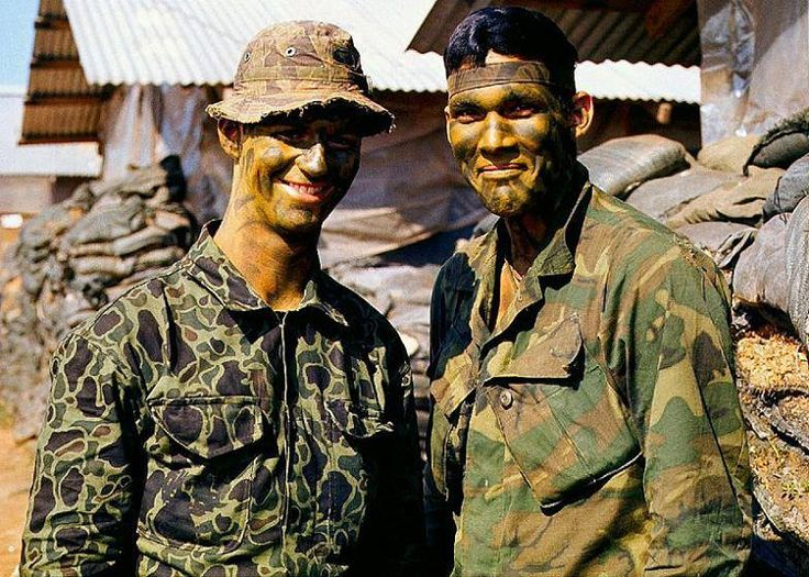 The same LRRP pictured wearing his distinctive ROK Beo Gam camouflage fatigues. He also wears a tigerstripe boonie, while his buddy wears a green dominant ERDL camouflage jacket.
