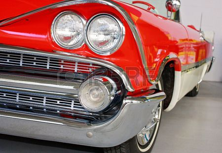 front side view of red and white classic car