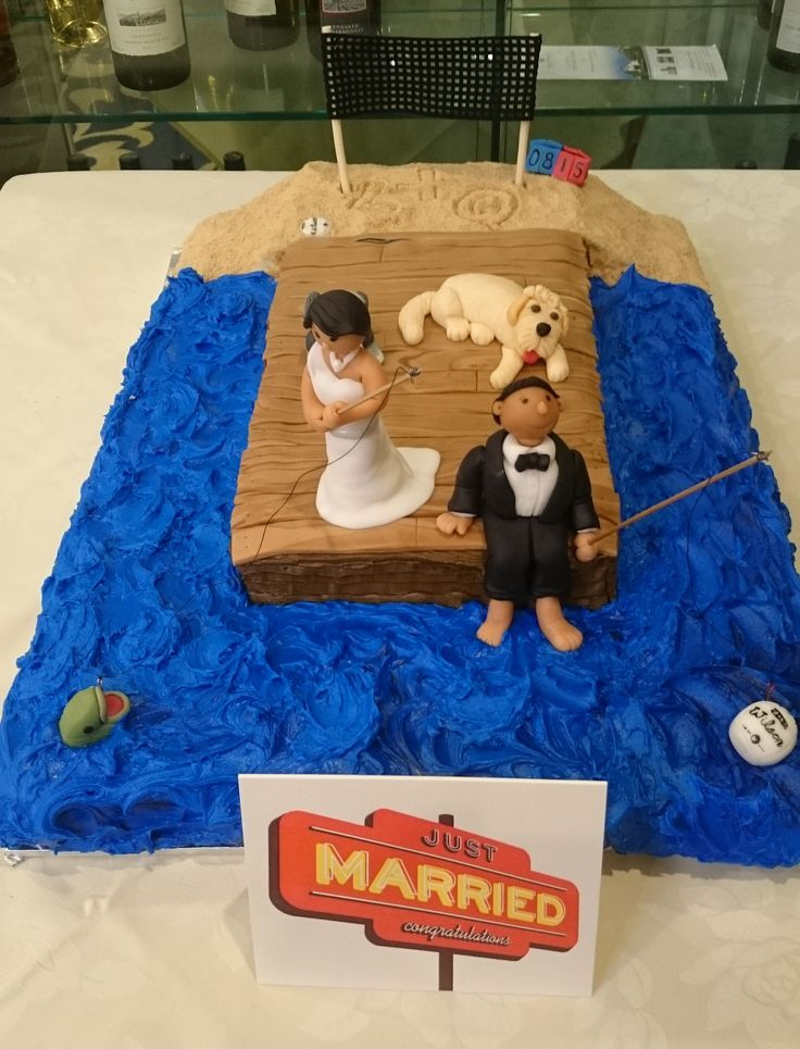 Beach volleyball and fishing off a dock wedding cake.