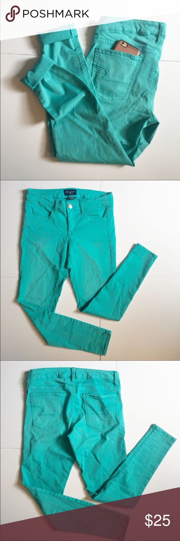 "American Eagle Super Stretch Aqua Pants American Eagle Blue / Teal / Aqua / Dark Mint colored skinny jeans/pants. 35"" long, 27"" inseam, ankle cuff 4 1/2"" laying flat, knee 6 1/2"" flat, thigh 9 1/2"" flat, waist 14 1/2"" laying flat. 54% cotton, 43% rayon, and 3% spandex. Minor wear- Good condition! Style is super stretch skinny pant. NO TRADES. American Eagle Outfitters Pants Skinny"