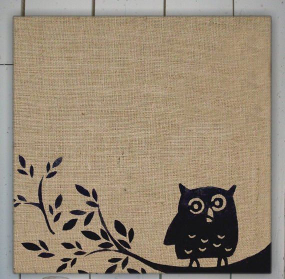 burlap on cork board then an easy stencil.  I love this look.  I want to do this with a chunky frame and hooks on the bottom
