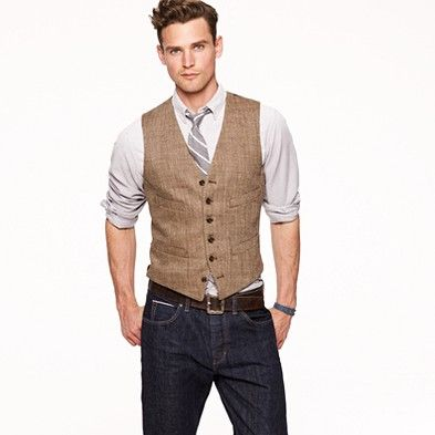 A must-have for every well-dressed gent's wardrobe: a herringbone vest, crafted in the finest Italian linen