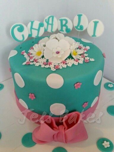 Turquoise cake with polka dots and a bow by Jess Bakes www.jessbakes.net