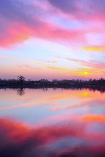 calm pink clouds, still reflective water