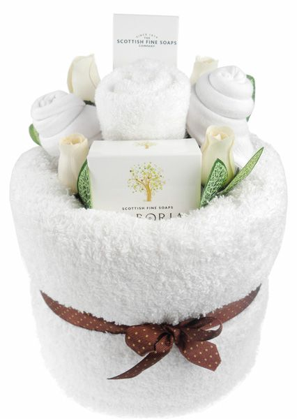 Delight Me White Pamper Cake Handmade by us and unique, this pamper cake is a lovely gift idea that is sure to delight. We use the best quality ingredients including 100% ring spun cotton yarn bath towel, making it very soft and absorbent. It's then filled with 100% cotton facecloth, 2 pairs of ladies socks, a special Arboria soap and an indulgent hand and nail cream by Scottish Fine Soaps. http://www.sayitgifts.co.uk/Delight-Me-White-Pamper-Cake-p/delpcake.htm