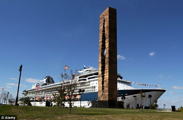 A cruise ship pictured alongside The Teardrop monument in New York