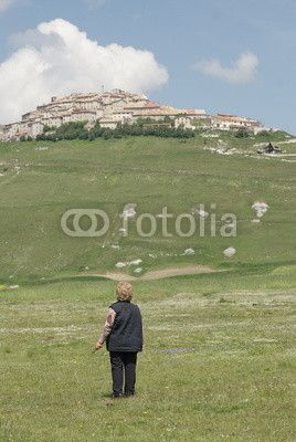 Old woman front of  the village of Castelluccio, near Norcia