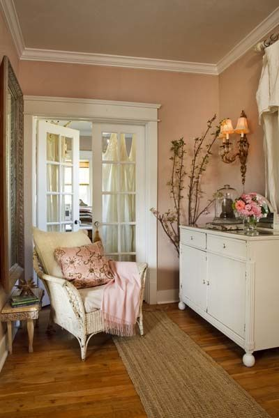 I like the peachy pink walls with the cool white and golden wood.  Nice