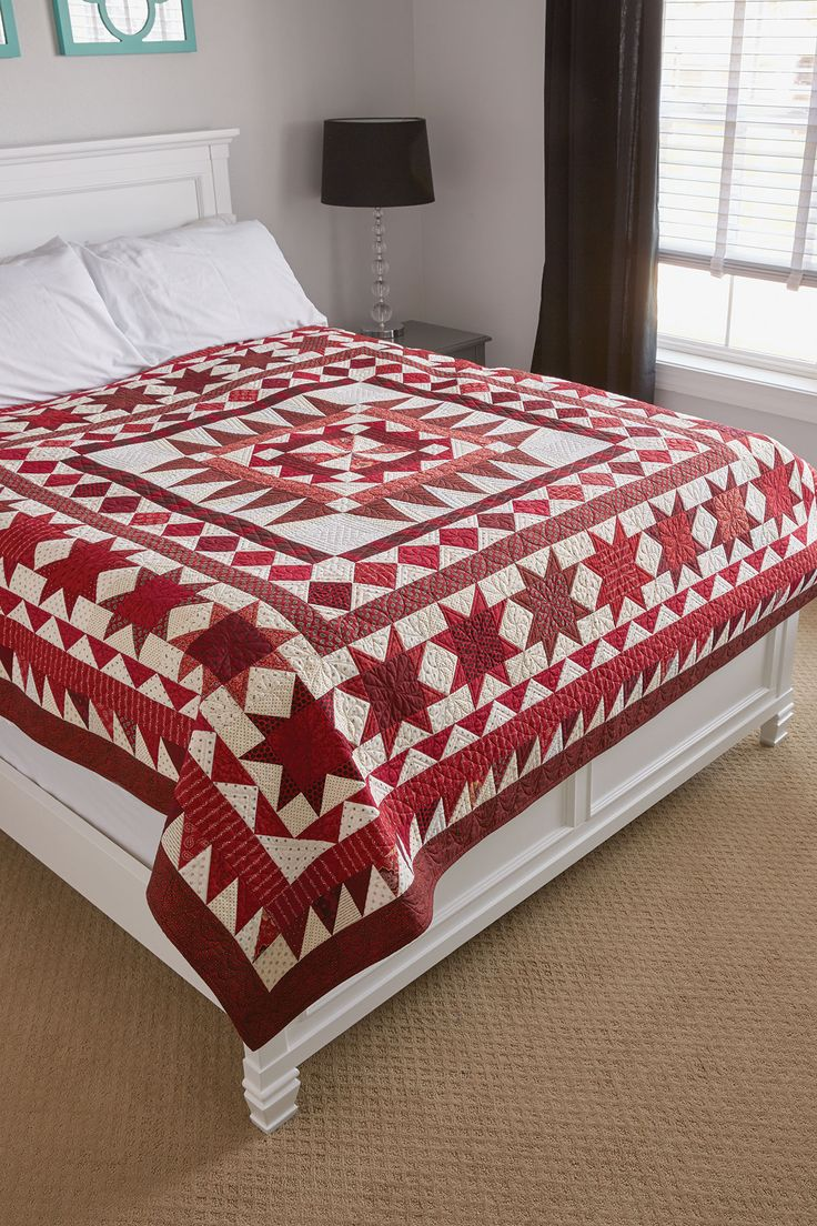 RED BETWEEN THE LINES by Marianne Fons: This lovely quilt was created for the opening exhibit at the Iowa Quilt Museum in Winterset, Iowa. We supply full-sized templates and our Sew Easy instructions for cutting half-square and quarter-square triangles. Red and white are quilt colors have been favorites for traditional quilters for centuries and this red and white quilt pattern pays homage to that.