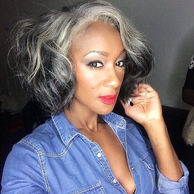Beautiful woman with silver, black, white, gray hair. Short hairstyle.