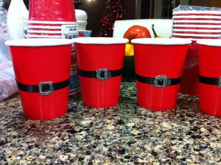 Santa cups  Red cups, black ribbon and glitter glue.  Made for kaceys santa theme birthday