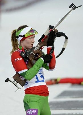 Lock & load & ski. Darya Domracheva of Belarus in action during the women's 15K individual biathlon race.