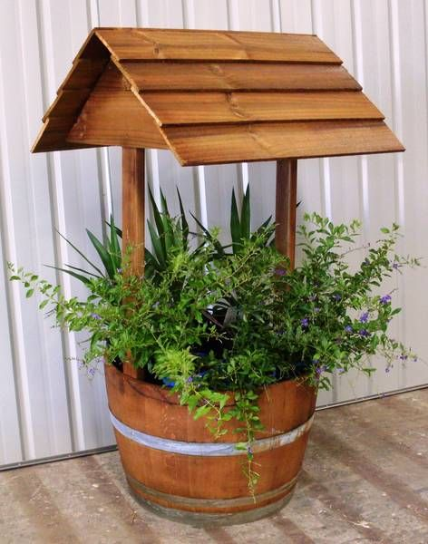 I love the combination of the traditional wishing well style planter and the fashionable wine barrel planter.