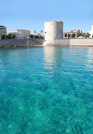 One of the most underrated places in Italy, Alghero. Crystal Blue and Azure water with Old Spanish Fort in the Mediterranean...perfect...simply
