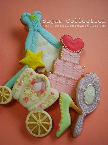 Cinderella cookies (photo only). The three getting my attention are the carriage, mirror and tier cake. I especially think the mirror is very original and such a cute idea. It might be cute to put a hard candy backing on it it actually and frost the whole thing.