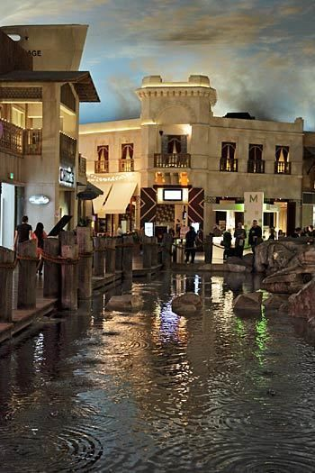 "The sky darkens before an indoor weather cell lets loose with rain that falls into a mini-harbor amid the Miracle Mile mall at Planet Hollywood. Little kids will enjoy jumping on rocks and getting wet in the ""storm"" -- and then ducking into a nearby Ben & Jerry's. It rains on the hour Mondays-Thursdays and on the half-hour on weekends. Check the weather forecast at www.miraclemileshopslv.com/entertain.php?id=19"