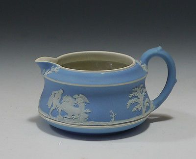 Early 20th century Wedgwood creamer featuring a base relief of friendship comforting pain based on a design by Lady Elizabeth Templetown (The New Bride). It is an example of art and craft that was taken a step further, combining art and craft with a production line in order to manufacture quality craft products to a wider class of people.