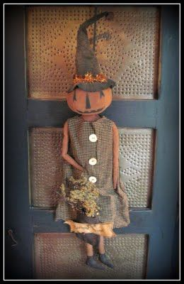Primitive Pumpkin Doll...on an old pie safe.