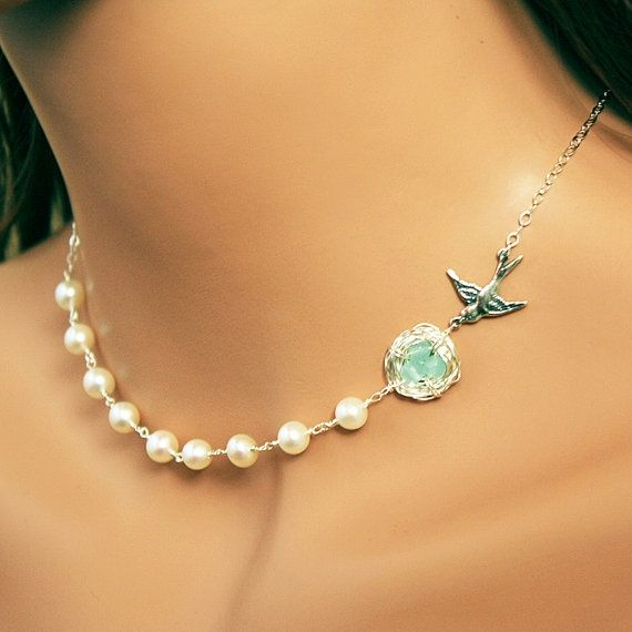 Pearl and robin's nest necklace