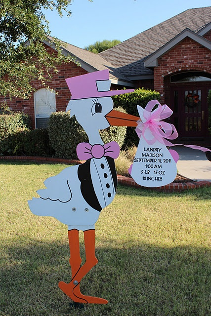 Stork. So cute for baby shower. Just change the details on the sign